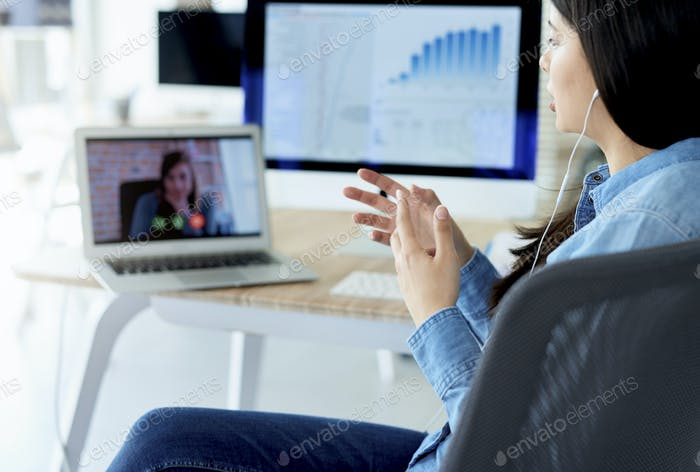 Woman having video conference in the office