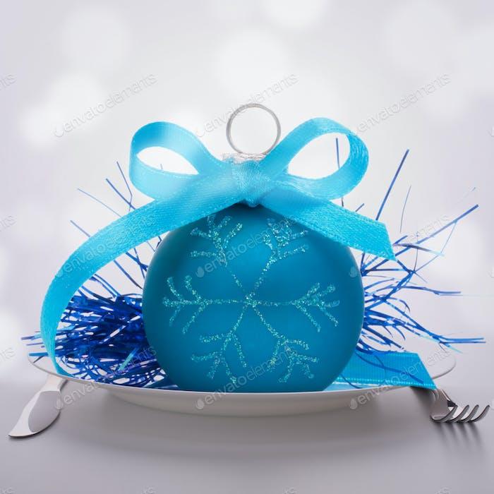 Christmas ball decoration on plate.