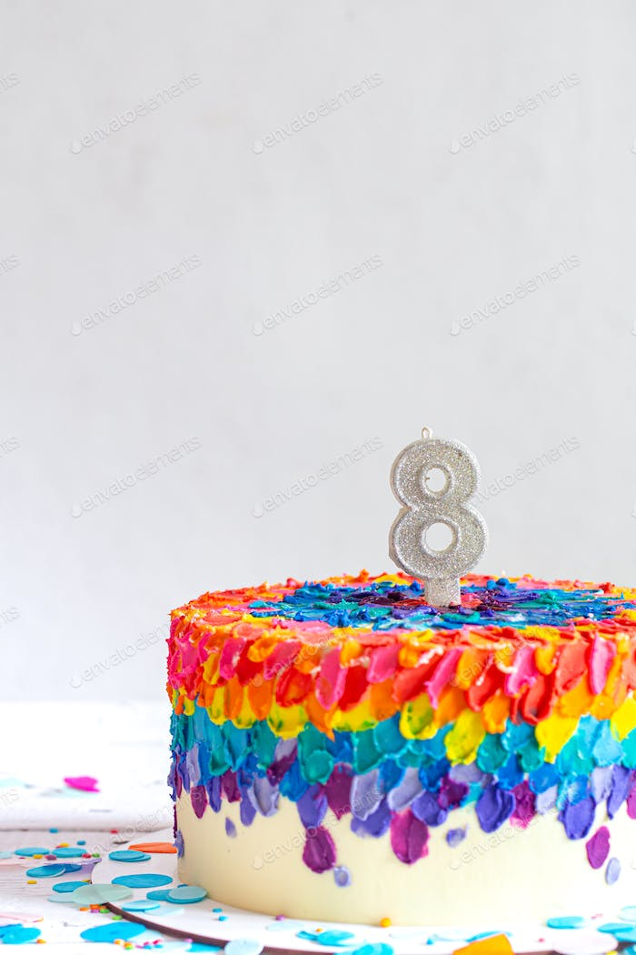 Colorful big handmade cake with number eight.