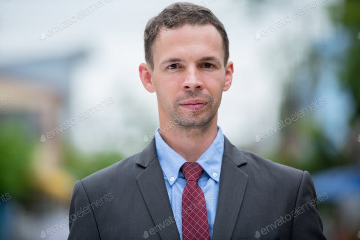 Businessman wearing suit in the streets outdoors