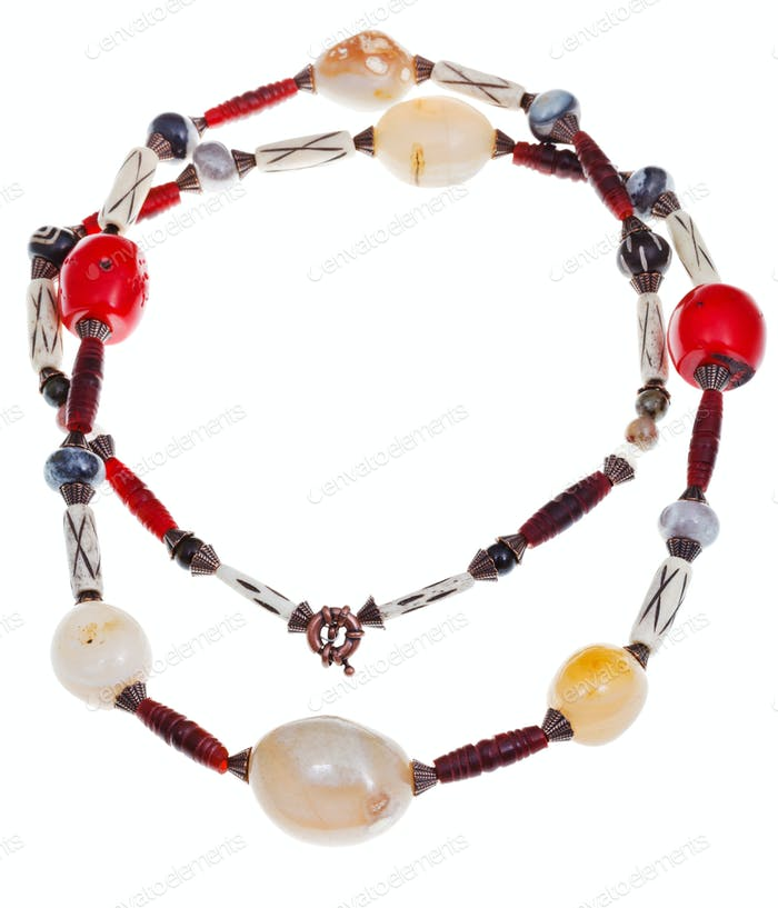 necklace of lagate, red coral, carved horn, bone