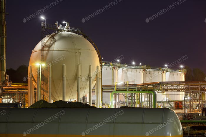 Oil And Gas Storage Tanks At Night
