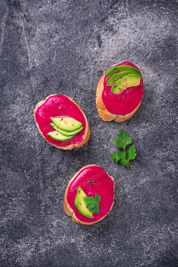 Healthy vegan toasts with beetroot hummus