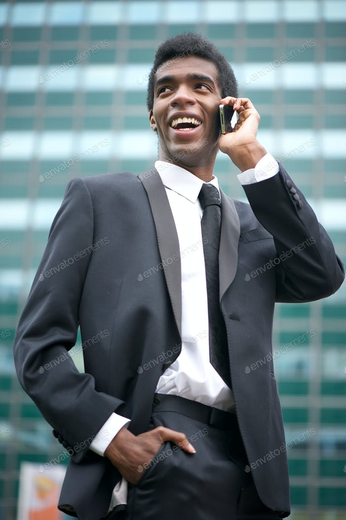 Portrait of a happy african american businessman on the phone