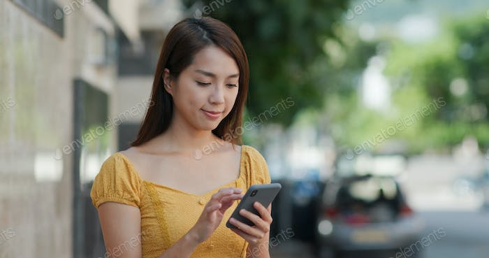Woman look at the phone
