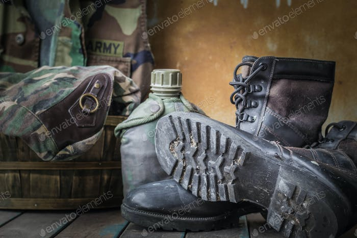 boots of soldiers on wooden