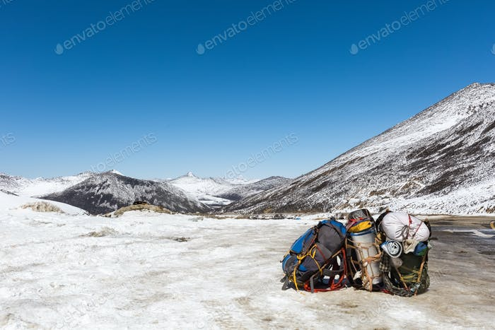 pilgrims backpack with snow mountain