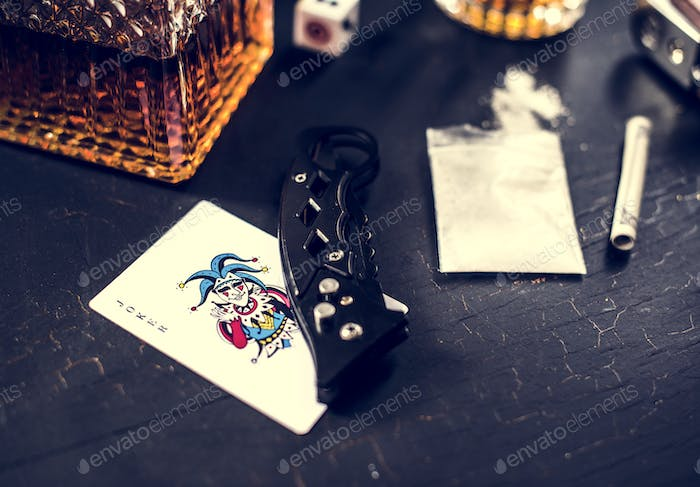 Drugs gun knife on the table