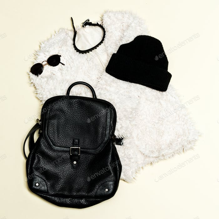 Black fashion set. Fur coat and black accessories. Bag, sunglass