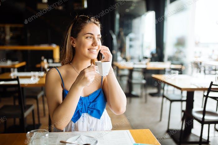 Stunning woman enjoying her coffee in restaurant