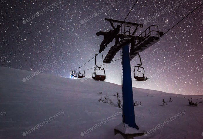 Cable cars hang on cables in a silent night