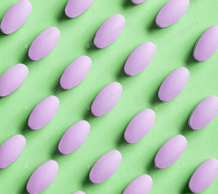 purple pills on green background