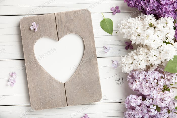 Spring background with flowers and photo frame
