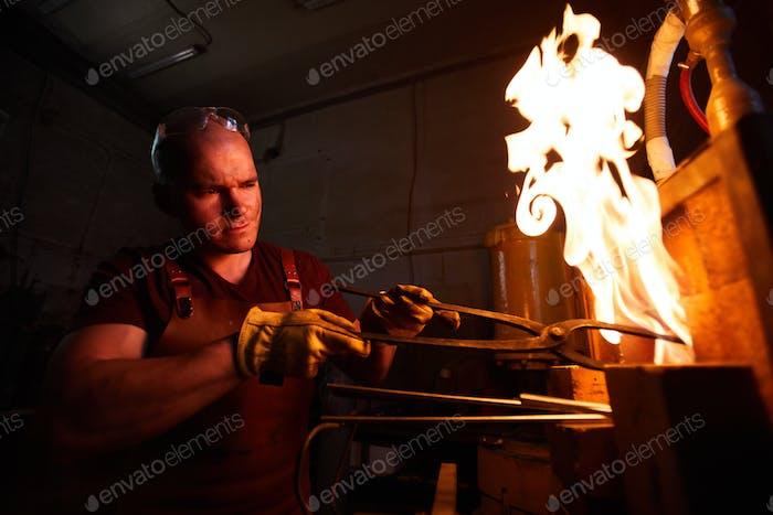 Heating steel piece in furnace