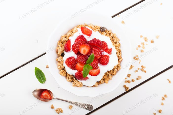 Yogurt with granola and fresh strawberries