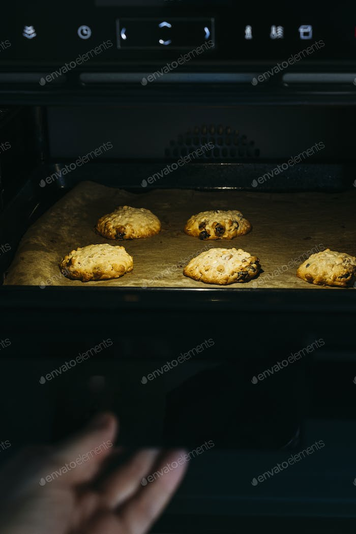 Cooking cookies in the oven.