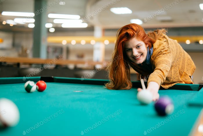 Beautiful woman playing snooker