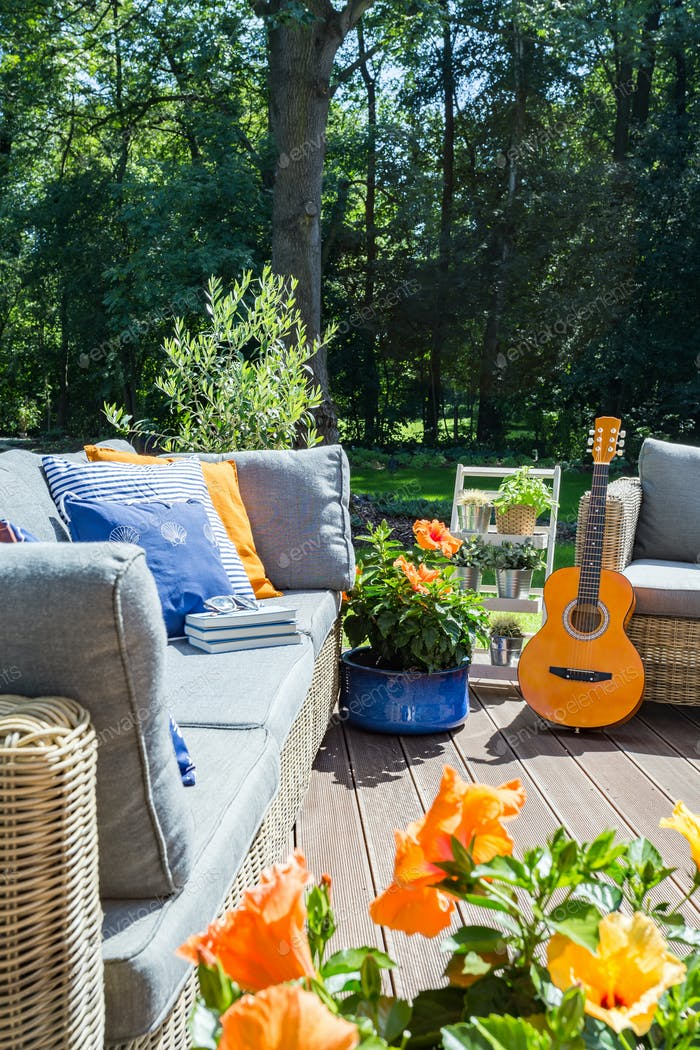 Cozy terrace with flowers and guitar