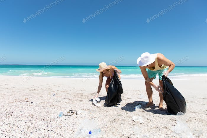 Young couple picking up the rubbish
