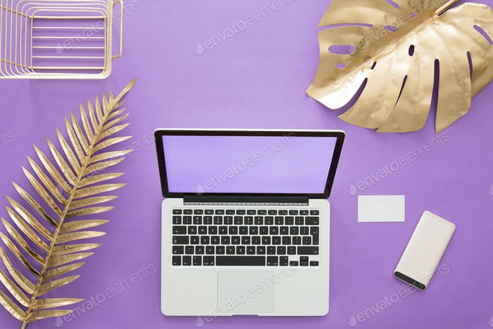 Gold leaves on violet background