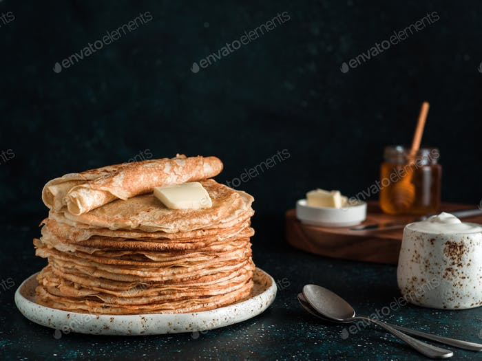 russian pancakes blini on black with copy space