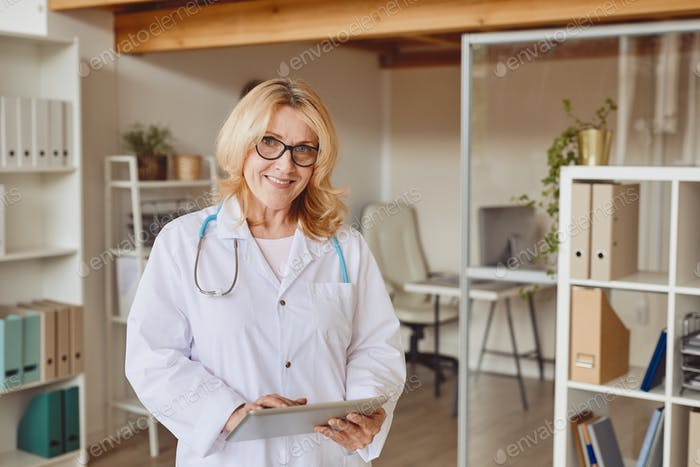 Mature Female Doctor Posing in Clinic