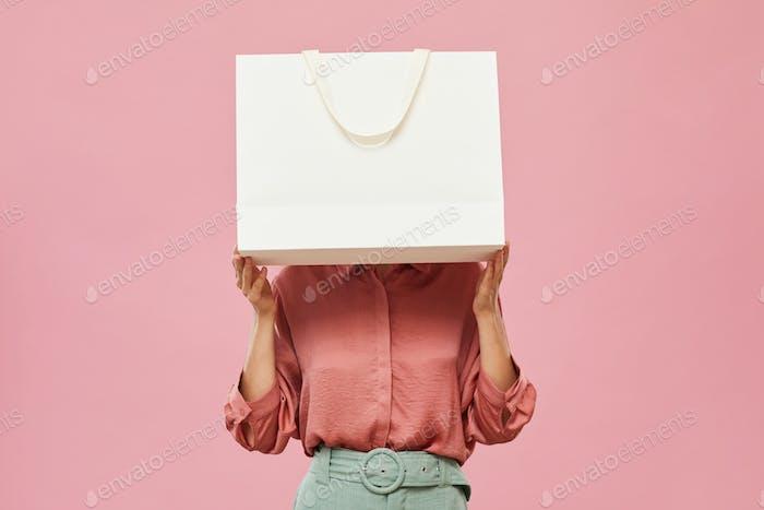 Woman hiding behind the bag