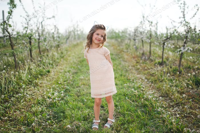 beautiful little girl in blooming garden