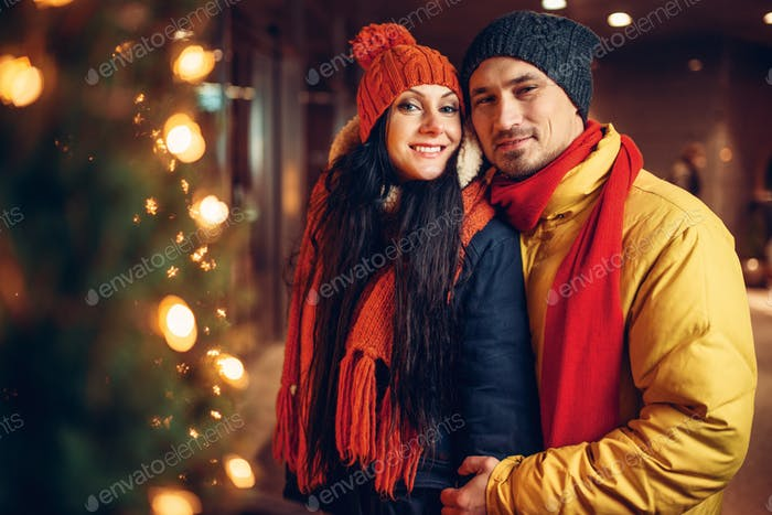 Winter evening, city walking of love couple