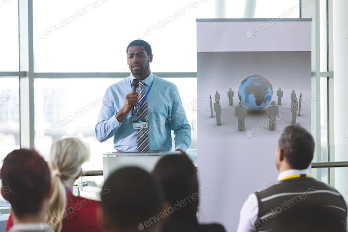 Businessman speaker speaking in business seminar in modern office building