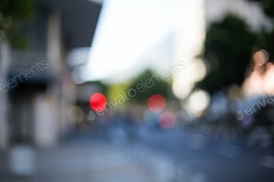 A blurry urban street scene