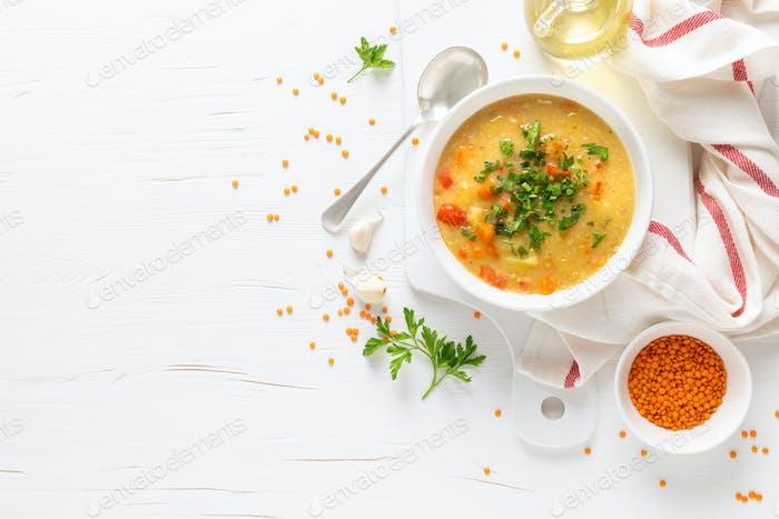 Vegetarian vegetable lentil soup with fresh parsley, healthy eating, top view