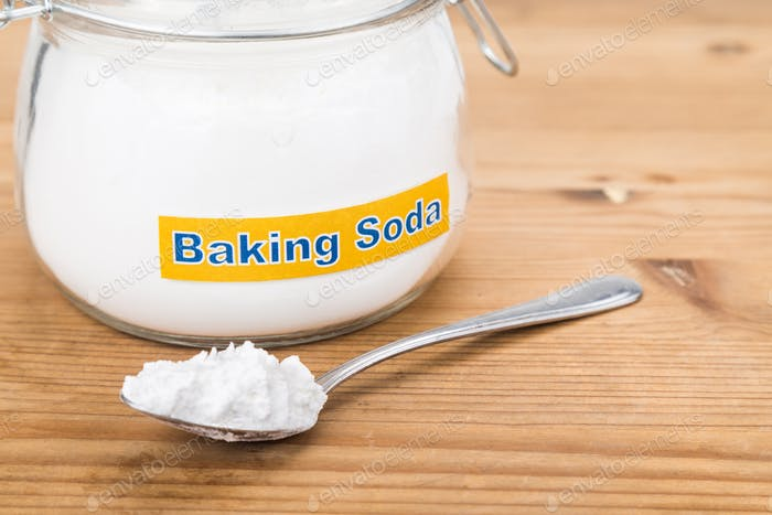 Jar and spoonful of baking soda for multiple holistic usages