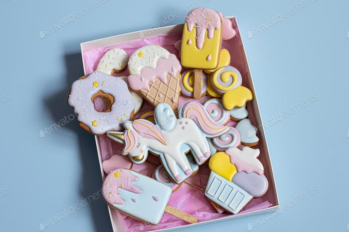 Close-up of bright glazed gingerbread cookies in a box.