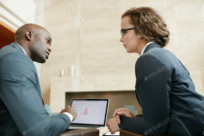 Business partners in serious discussions at restaurant