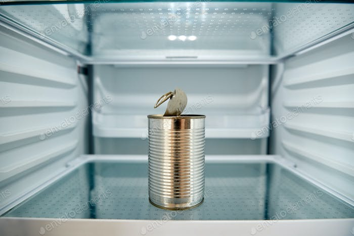 View Looking Inside Refrigerator Empty Except For Open Tin Can On Shelf