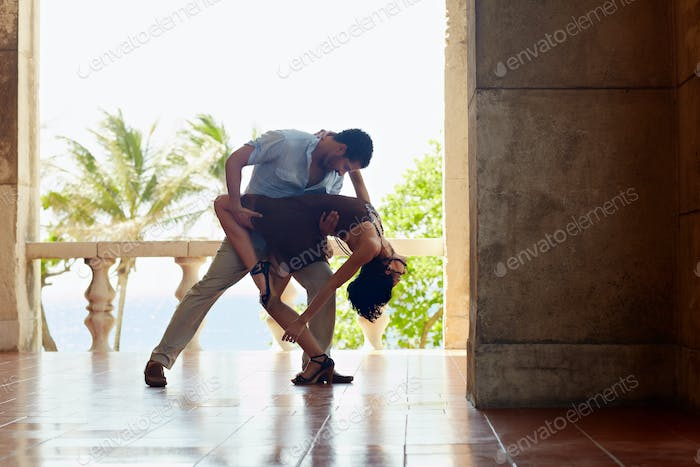 Latin American Man And Woman Dancing