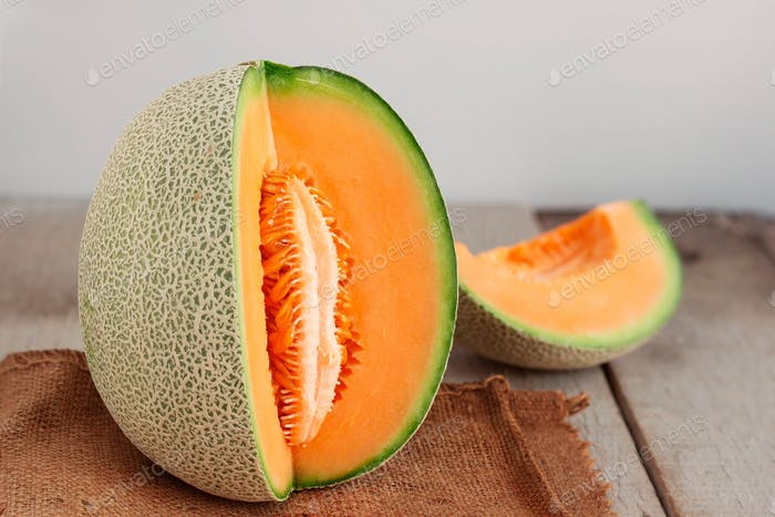 melon cut on wooden