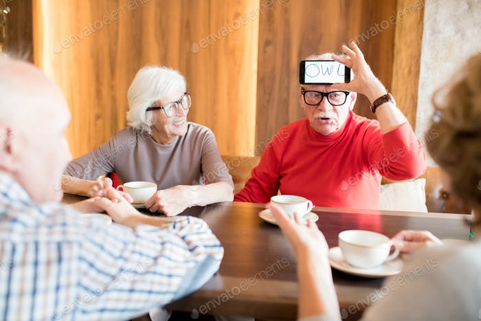 Elderly man explaining word on his forehead