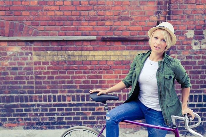 Hipster woman commute on road city bike