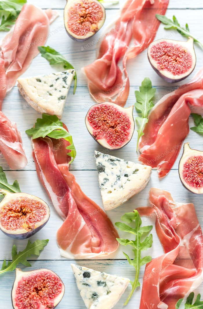 Slices of jamon with blue cheese and figs