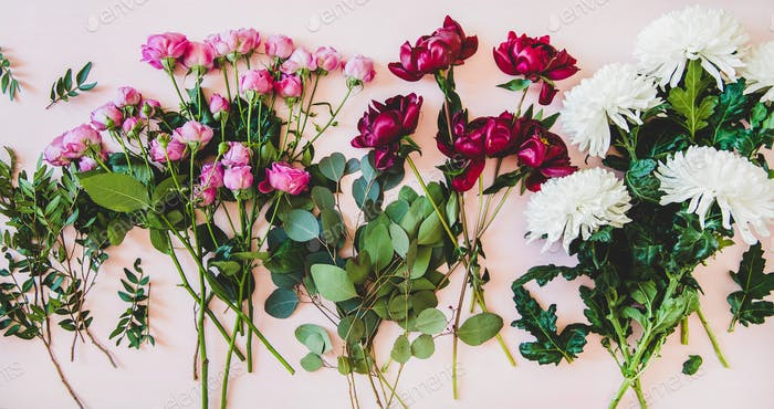 Flat-lay of purple peonies, pink roses and white chrisanthemums
