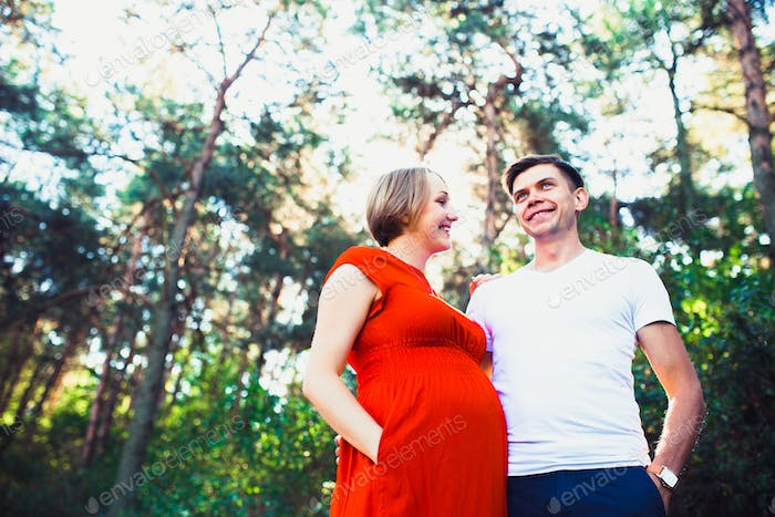husband tenderly cares for his pregnant wife