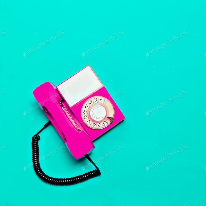 Vintage pink phone. Minimal design