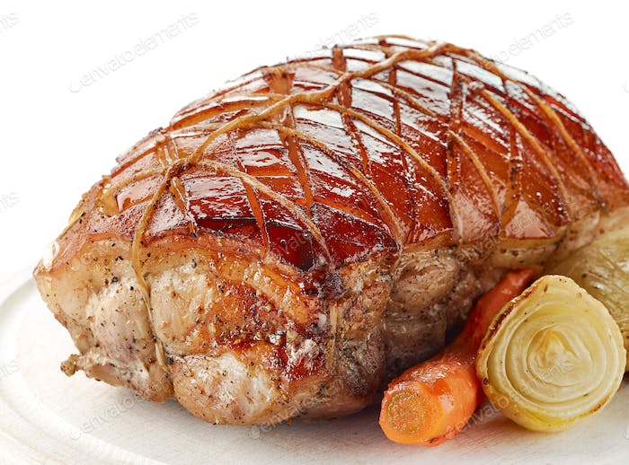 roasted pork on wooden cutting board