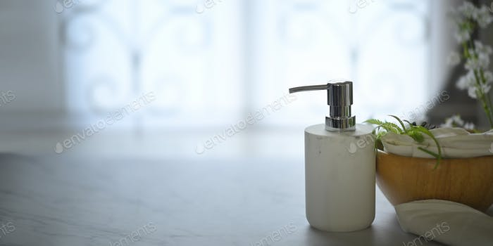 Pump dispenser bottle putting on marble texture.