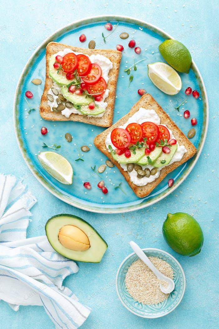 Toasts with feta cheese, tomatoes, avocado, pomegranate