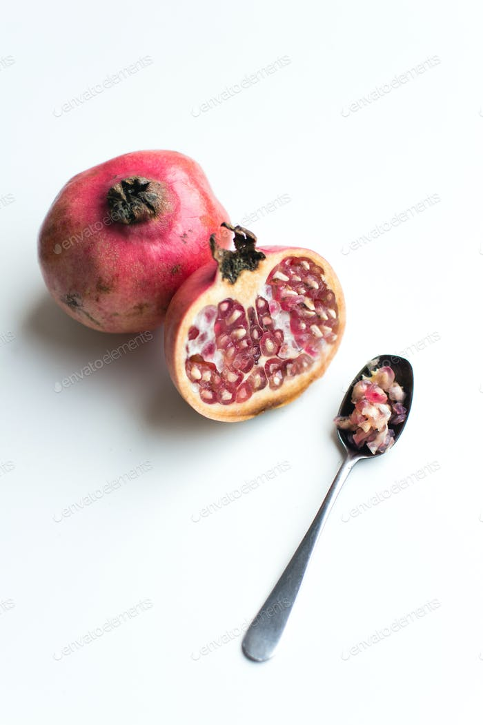 Fresh cut pomegranate on a white background