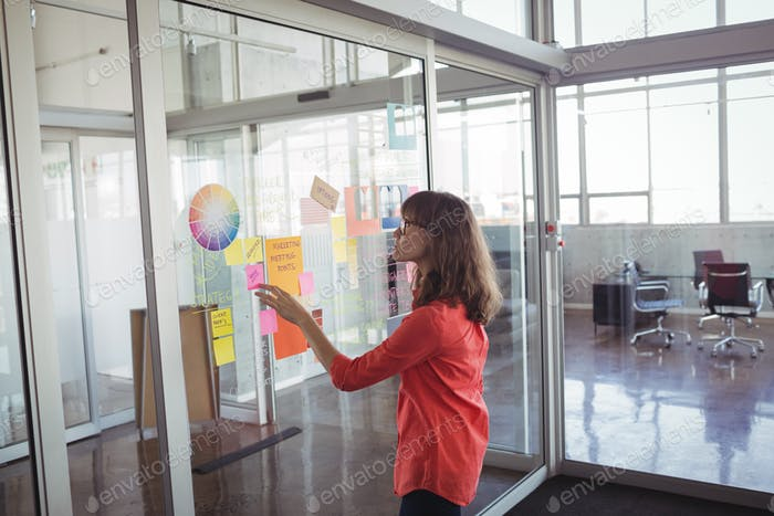 Businesswoman analyzing strategies in creative office