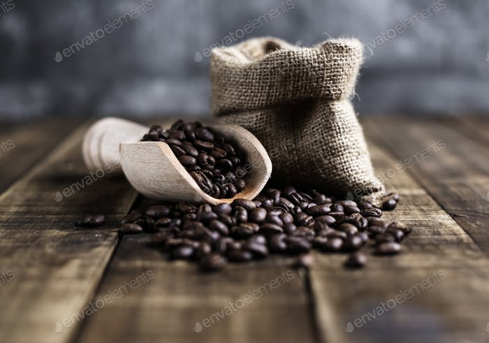 coffee beans with wooden scoop and bag